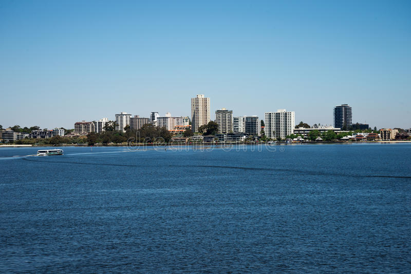 South Perth view from Elizabeth Quay Bridge with ferry crossing Swan River towards Mend Street jetty stock photography