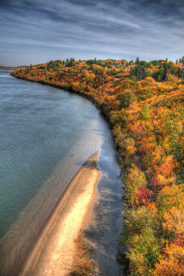 South Saskatchewan River. East shore of the South Saskatchewan River across from downtown Saskatoon. HDR image created by combining three different exposures stock images