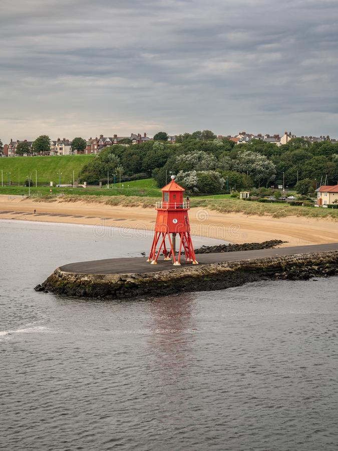 South Shields, Tyne and Wear, England, UK. September 05, 2018: View from the River Tyne towards the Herd Groyne Lighthouse, with South Shields in the royalty free stock photography