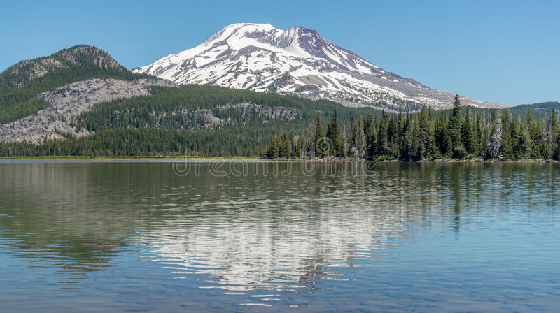 South Sister mountain reflecting in Sparks Lake stock photo
