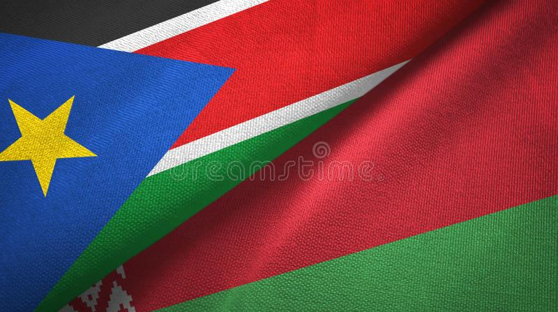 South Sudan and Belarus two flags textile cloth, fabric texture royalty free stock images