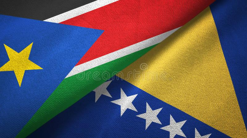 South Sudan and Bosnia and Herzegovina two flags textile cloth, fabric texture. South Sudan and Bosnia and Herzegovina flags together textile cloth, fabric royalty free stock photo