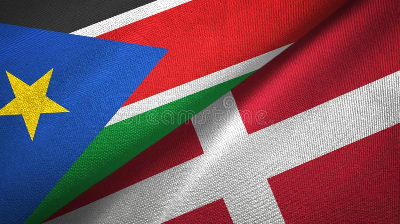 South Sudan and Denmark two flags textile cloth, fabric texture stock images