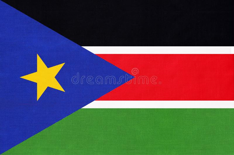 South Sudan national fabric flag textile background. Symbol of international world African country stock illustration