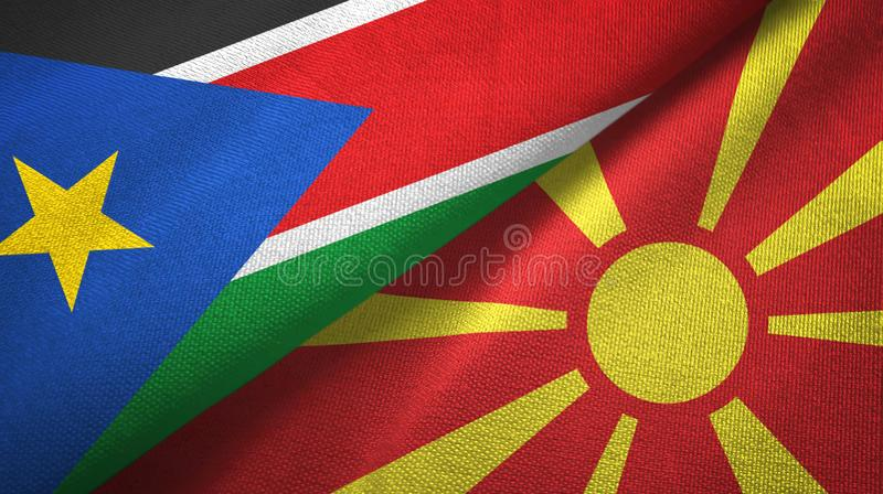 South Sudan and North Macedonia two flags textile cloth, fabric texture stock images