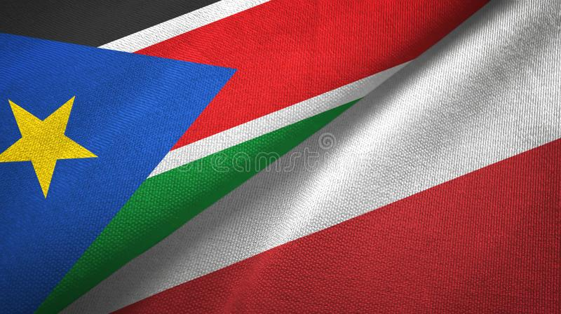 South Sudan and Poland two flags textile cloth, fabric texture royalty free stock photos