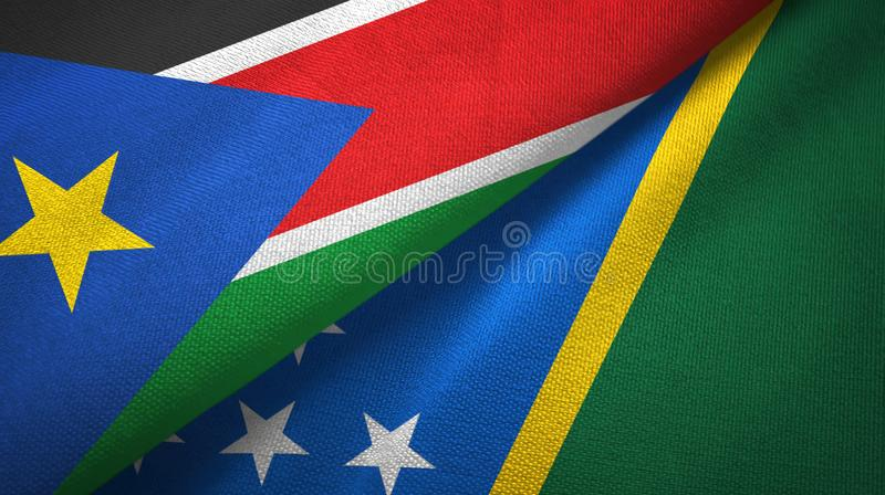 South Sudan and Solomon Islands two flags textile cloth, fabric texture stock photos