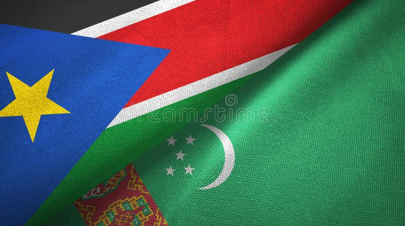 South Sudan and Turkmenistan two flags textile cloth, fabric texture royalty free stock photography