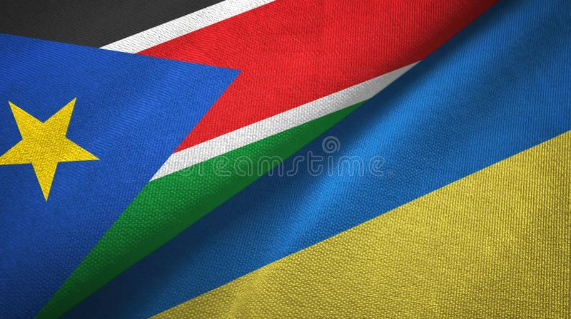 South Sudan and Ukraine two flags textile cloth, fabric texture royalty free stock photos