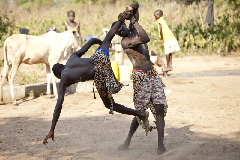 South Sudanese wrestlers. BOR, SOUTH SUDAN-DECEMBER 4 2010: Unidentified South Sudanese tribal wrestlers compete in a village north of Bor, South Sudan stock photo