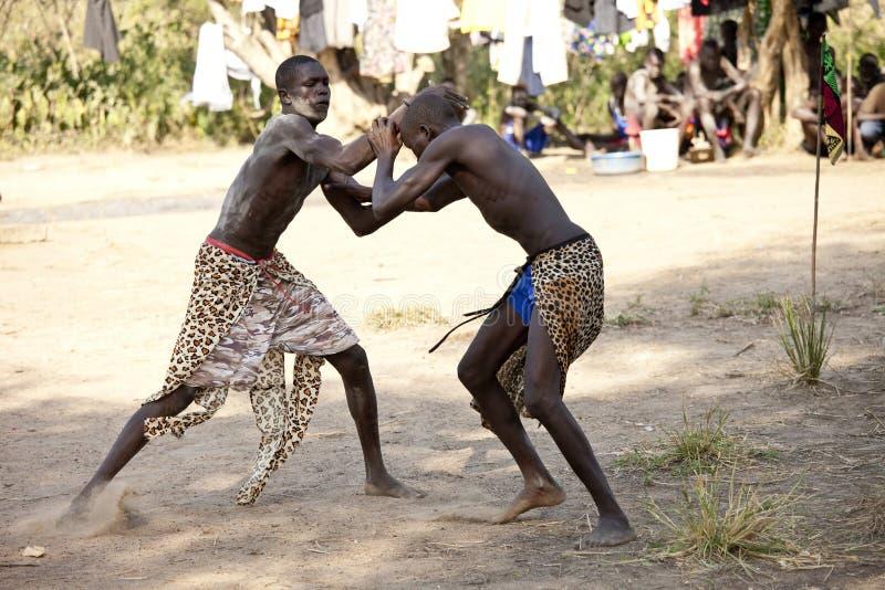 South Sudanese wrestlers. LILIIR, SOUTH SUDAN: DECEMBER 4 2010- Unidentified men wrestle in a tribal event south of Liliir, South Sudan stock photo