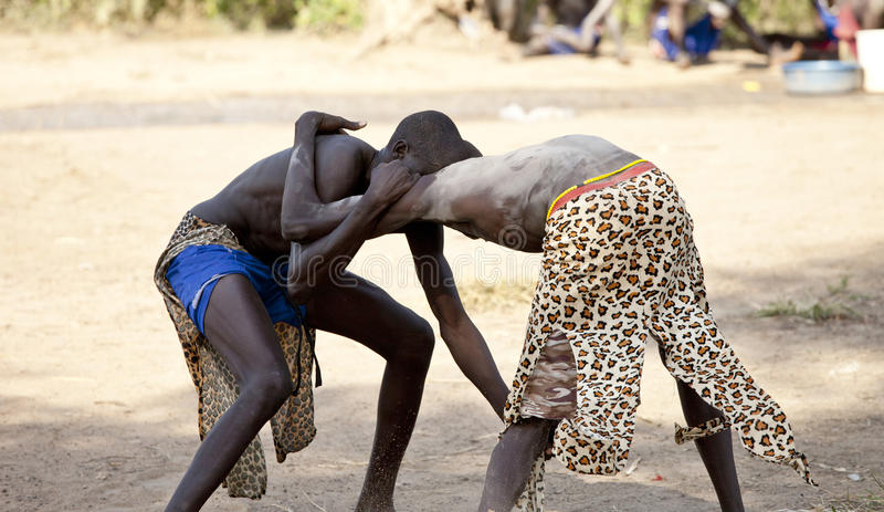 South Sudanese wrestlers in South Sudan. South Sudanese wrestlers in competition in a rural village in South Sudan royalty free stock photo