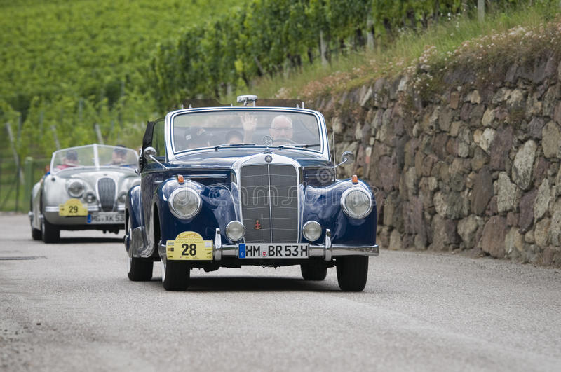 South tyrol classic cars_2014_Mercedes 220 CA Cabrio. Schenna, Italy - July 10, 2014: traditional car racing event for classic old time cars for several days royalty free stock image