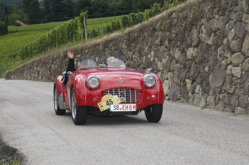 South tyrol classic cars_2014_Triumph TR3 roadster. Schenna, Italy - July 10, 2014: traditional car racing event for classic old time cars for several days stock photography