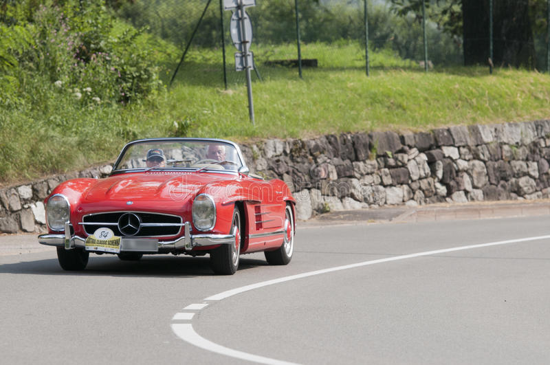 South Tyrol Rallye 2016_Daimler Benz 300 SL Roadster. Lateral frontal view of the Daimler-Benz 300 SL roadster with the number 84, built in 1962, 2975 CC royalty free stock photos