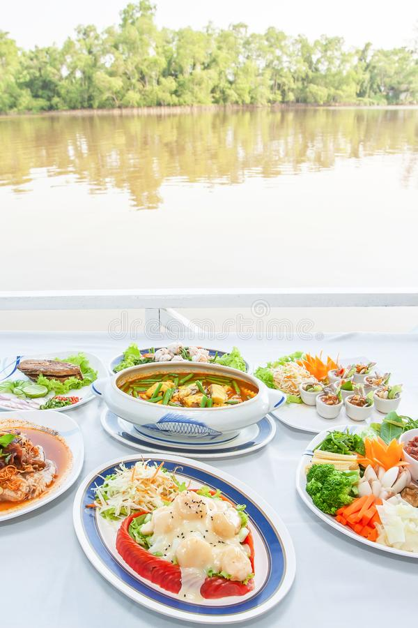 Southeast Asian cuisine set, Japanese shrimps with salad, Fish organs sour soup Thai style, Fish sauce Southern style, fried royalty free stock image