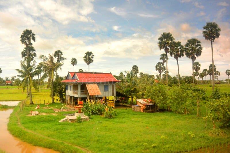 Southeast Asian landscape in rainy season 5, house with  roof. Southeast Asian landscape in rainy season 5, house with red roof, Cambodia royalty free stock images