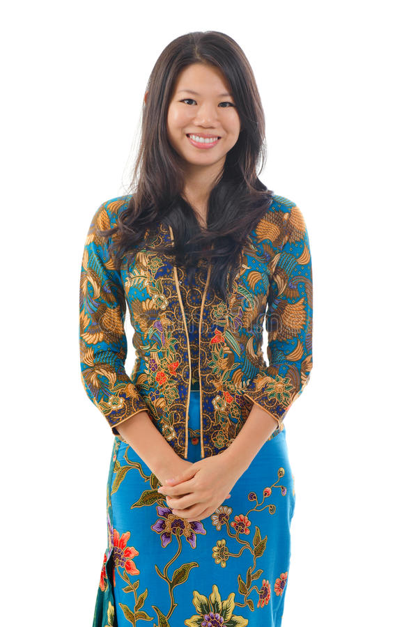 Southeast Asian woman in traditional batik kebaya royalty free stock images