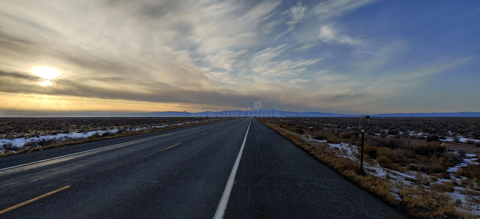 Southern Colorado Open road lonely Highway Sun clouds royalty free stock images
