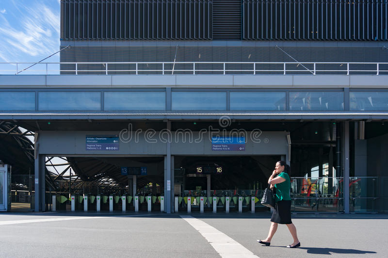 Southern Cross station entrance with pay gates and woman walking stock image