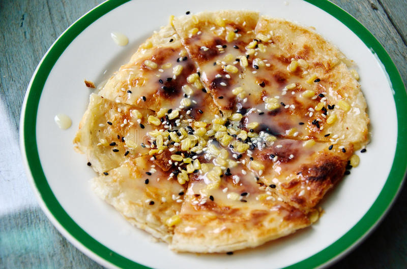 Southern flat bread. With sweetened condensed milk and seasame royalty free stock photos