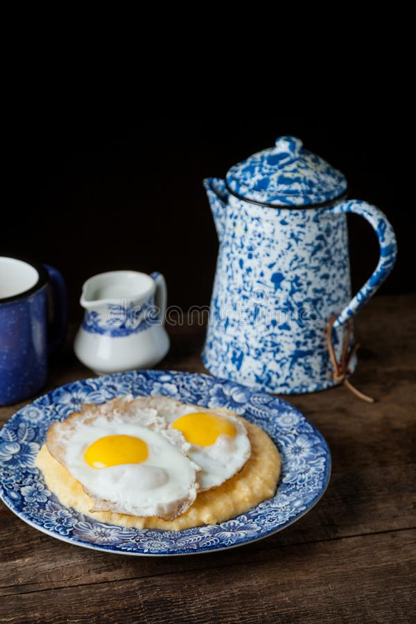 Southern style grits served with two sunny side fried eggs stock photo