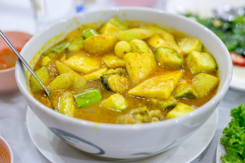 Southern Thai Spicy Sour Yellow Curry with Sea Bass stock images