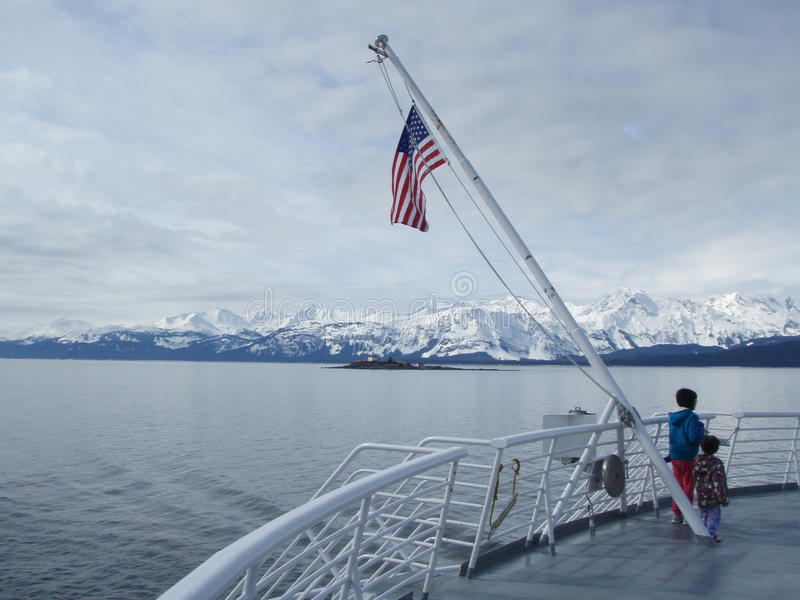 Southest Alaska Inside Passage. View from the stern of an Alaska Marine Highway Ferry as it sails from Juneau to Skagway along the Lynn Canal of the Inside royalty free stock images