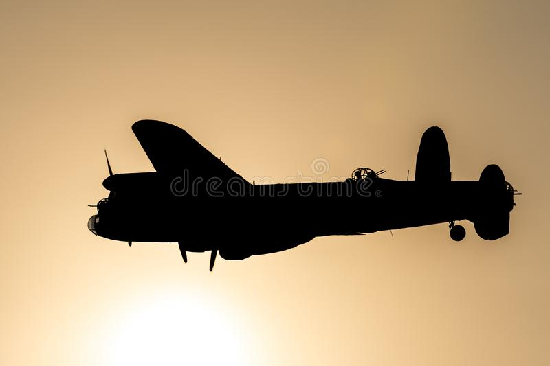 SOUTHPORT, UK JULY 8 2018: A photograph documenting the silhoue. Tte of the Avro Lancaster Bomber from the Battle of Britain Memorial Flight as it performs a stock photo