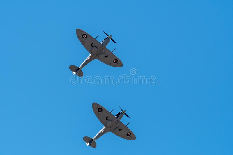 SOUTHPORT, UK JULY 8 2018: Two ex-RAF Spitfires perform a two sh. Ip display in the clear skies above Southport Beach for the annual airshow stock photography