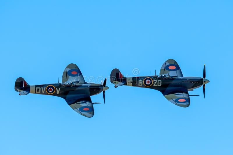 SOUTHPORT, UK JULY 8 2018: Two ex-RAF Spitfires perform a two sh. Ip display in the clear skies above Southport Beach for the annual airshow royalty free stock photos