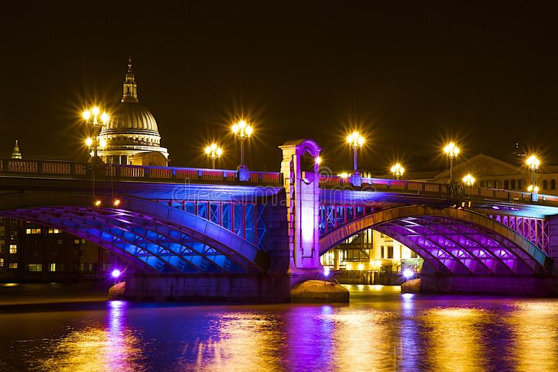 Southwark bridge at Christmas, London. Southwark bridge at night during Christmas, London, UK royalty free stock image