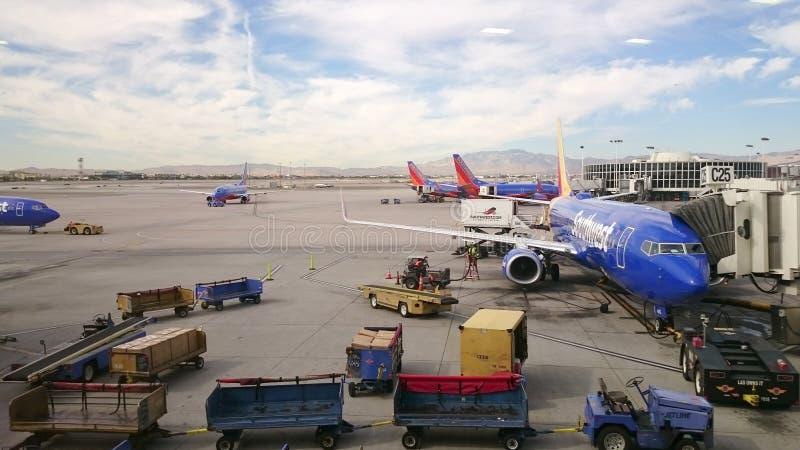 Southwest Airline Boeing 737 Airport. LAS VEGAS, SEP. 26: Southwest Airline airplane Boeing 737 being loaded by baggage handler at the tarmac of McCarran stock photo