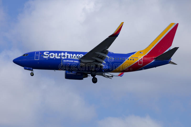 Southwest airline passenger jet Boeing 737. Coming in for a landingin West Palm Beach, Florida. Southwest Airlines features a fleet entirely made up of Boeing royalty free stock photos