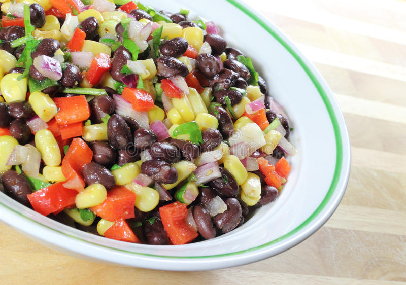 Southwest Black Bean Salad. In a bowl sitting on a table royalty free stock images