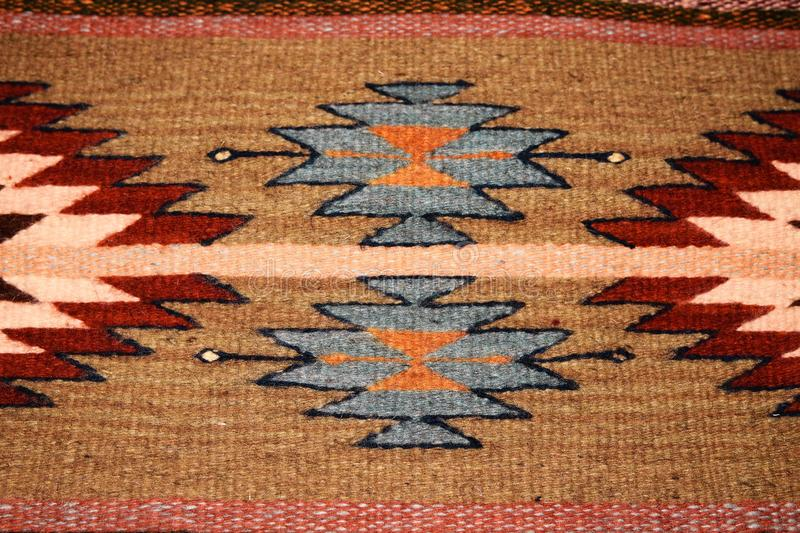 Southwest design in woven carpet royalty free stock image