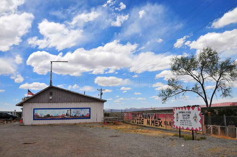 Southwest Landscape with Highway Shop at the Continental Divide. Southwest Landscape at the Continental Divide with highway shop, mesa, blue sky and clouds royalty free stock photos