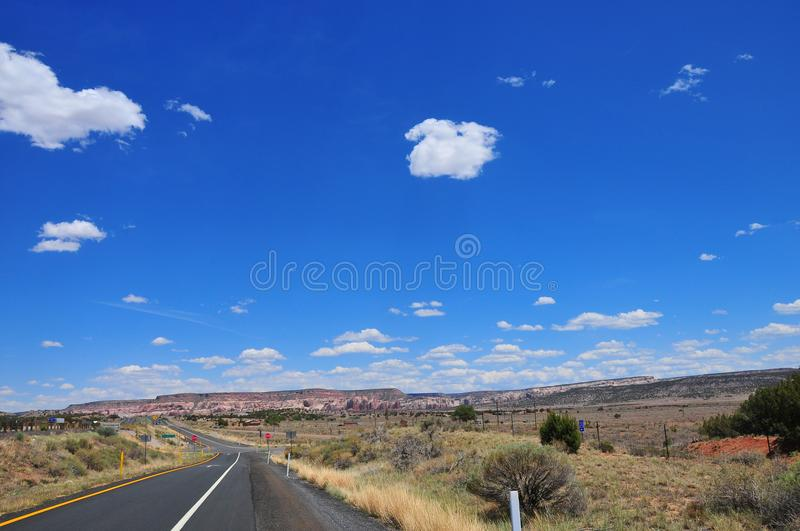 Southwest Landscape with Highway. Mesa, blue sky and clouds stock photography