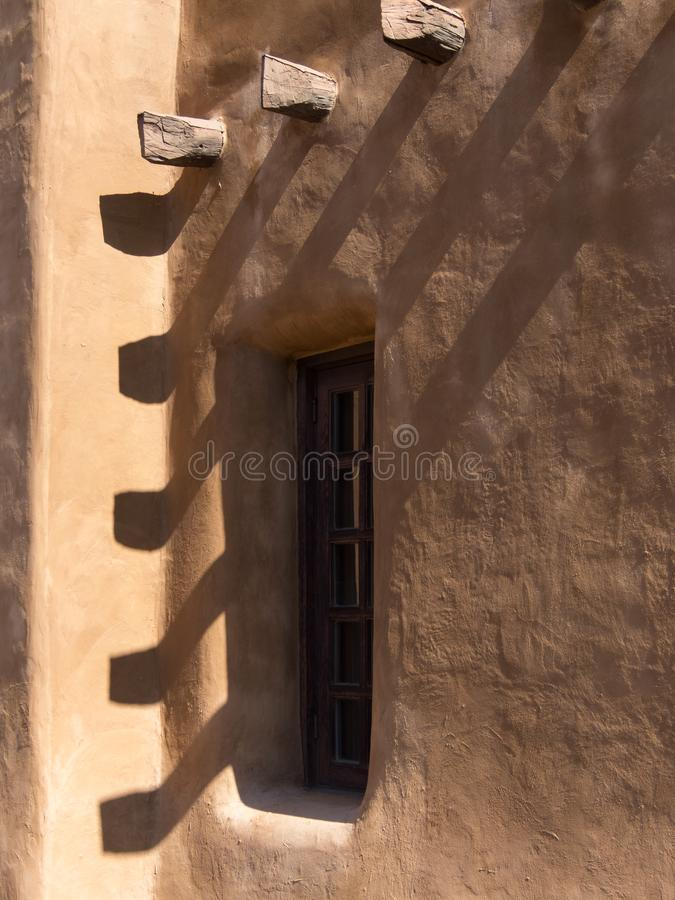 Southwestern architecture, window in adobe wall royalty free stock images