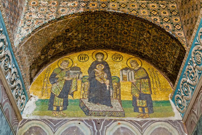 Southwestern entrance mosaic. ISTANBUL - MAY 01, 2014: Christian mosaic icon in Cathedral mosque Hagia Sofia. Southwestern entrance mosaic `Mother of God` The stock photos