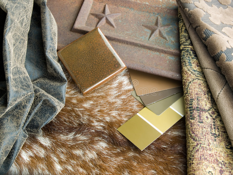 Southwestern interior design plan. A cowhide with aged leather sample, ceramic handcrafted tile, paint and fabric swatches. Rustic cast iron panel as a royalty free stock image