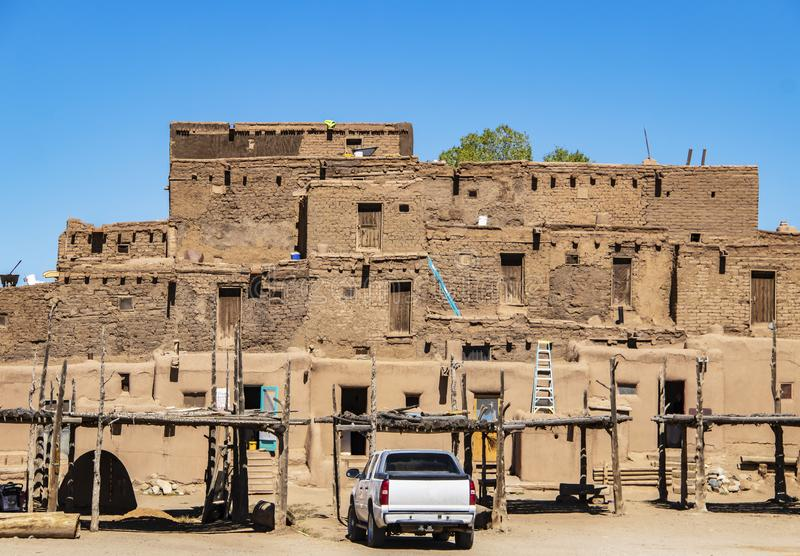 Southwestern Pueblo where Native Americans currently live during preparations for their annual harvest celebration - traditional o stock photography