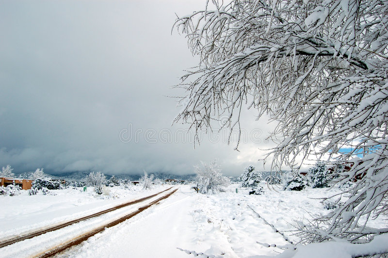 Southwestern Snowstorm. View of a snowy dirt road in New Mexico after a snowstorm royalty free stock photography