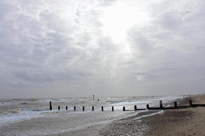 Rough Seas at Southwold, Suffolk, UK. Southwold, Suffolk, England - the sea-front with dramatic sky and rough seas royalty free stock photography