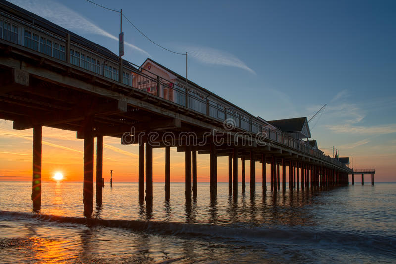 SOUTHWOLD, SUFFOLK/UK - MAY 24 : Sunrise over Southwold Pier Suffolk on May 24, 2017 stock photography