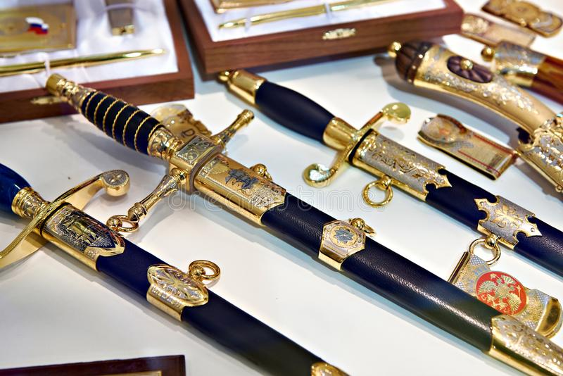 Souvenir blade weapons in store. Souvenir blade weapons on store shelves royalty free stock photos