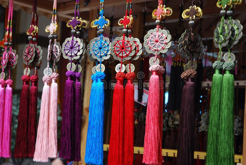 Souvenir from China, lucky charms knot with tassel. Souvenir from China. Lucky charms with coins knot and tassel for sale on a street market in Shanghai royalty free stock photos