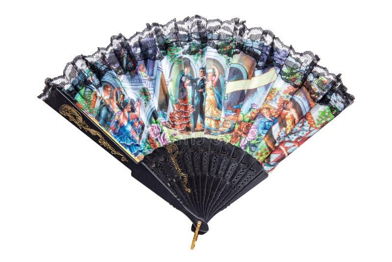Souvenir espagnol Belle fan espagnole traditionnelle colorée avec la jante noire de dentelle d'isolement sur un fond blanc images libres de droits
