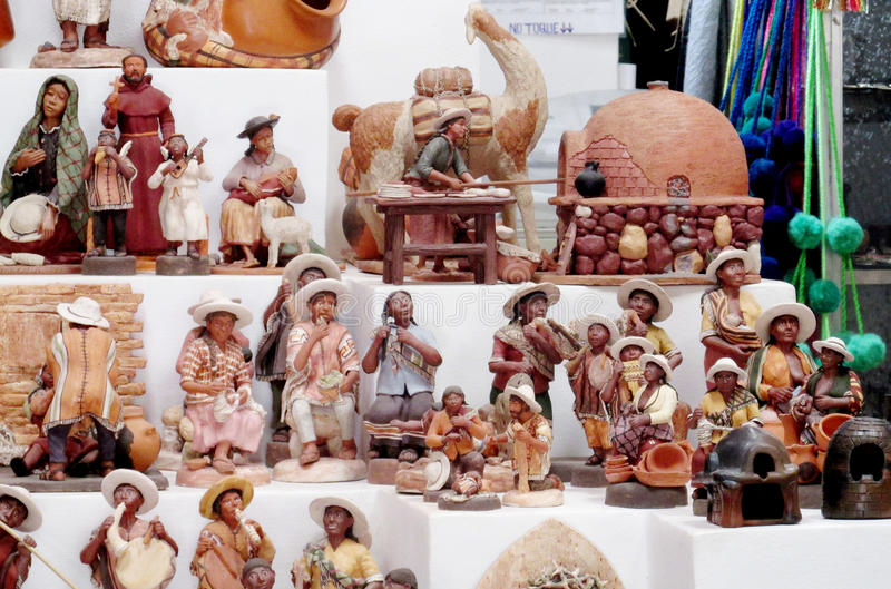 Souvenir indian figures. Souvenir cacti figures at suvenir shop. State Missiones, Argentina. Colored cups for mate. Bambillya calabash sold as souvenirs for stock photography