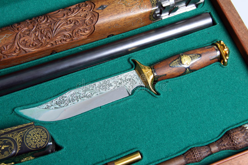 Souvenir knife in case. With hunting gun stock photography